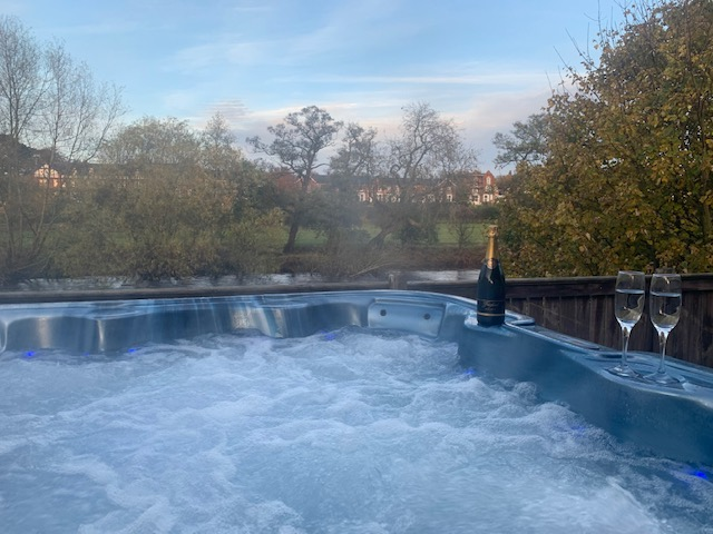 Celebrate in your own private hot tub at Riverside Lodges